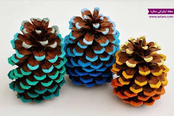 نمونه های زیبا از تزیین میوه کاج با اکلیل و رنگ